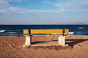 Rafina is a beach resort located on the eastern coast of Attica in Greece, just 25 miles or so from the centre of Athens. A bench looking out to sea.