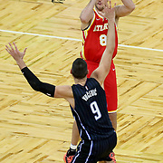 ORLANDO, FL - MARCH 03: Danilo Gallinari #8 of the Atlanta Hawks attempts a shot over Nikola Vucevic #9 of the Orlando Magic during the second half at Amway Center on March 3, 2021 in Orlando, Florida. NOTE TO USER: User expressly acknowledges and agrees that, by downloading and or using this photograph, User is consenting to the terms and conditions of the Getty Images License Agreement. (Photo by Alex Menendez/Getty Images)*** Local Caption *** Danilo Gallinari; Nikola Vucevic