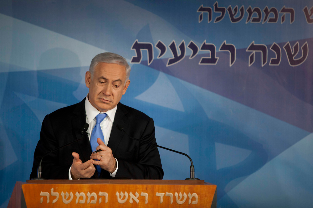 Israel's Prime Minister Benjamin Netanyahu gestures as he speaks during a press conference marking the start of the fourth year of his government in power, at the new premises of Government Press Office in Jerusalem, on April 3, 2012.