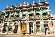 Ornate colonial style building alone Jimenez del Campillo street in the central historic district of Coatepec, Veracruz State, Mexico.