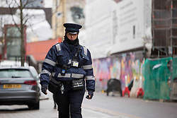 """© Licensed to London News Pictures.20/01/2021, London,UK. A parking enforcement officer is seen in Hackney, east London. The Department for Transport (DfT) plans to charge motorists for minor traffic violations which could result in automatic fines of £70. Civil penalties will be handed by nearly 300 local authorities outside London, instead of being imposed by the police. According to the DfT, the process will take """"several months to bring into force"""". Photo credit: Marcin Nowak/LNP"""