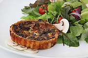 Savoury individual quiche tart with green salad