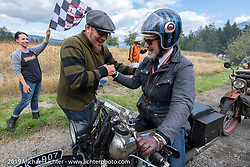 Paul d'Orleans is greeted by Jason Sims as he crosses the finish line of the Motorcycle Cannonball coast to coast vintage run. Stage 15  (51 miles - the Grand Finish) from The Dalles to Stevenson, OR. Sunday September 23, 2018. Photography ©2018 Michael Lichter.