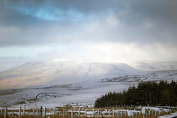 © Licensed to London News Pictures. 16/04/2016. Ribblehead UK. Picture shows the Snow covered Whernside mountain this morning after last night's snow fall. Photo credit: Andrew McCaren/LNP