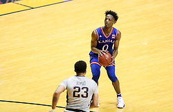 Jan 15, 2018; Morgantown, WV, USA; Kansas Jayhawks guard Marcus Garrett (0) shoots a three pointer during the first half against the West Virginia Mountaineers at WVU Coliseum. Mandatory Credit: Ben Queen-USA TODAY Sports