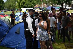 © Licensed to London News Pictures. 15/06/2021. London, UK. Bailiffs move in on a camp of protesters on Shepherd's Bush Green calling themselves 'Lovedown' who have been protesting the lockdown, mask wearing and the vaccination programme. Photo credit: Guilhem Baker/LNP