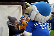 Haydon the Womble meeting young fan with a Haydon the Womble teddy during the EFL Sky Bet League 1 match between AFC Wimbledon and Barnsley at the Cherry Red Records Stadium, Kingston, England on 19 January 2019.