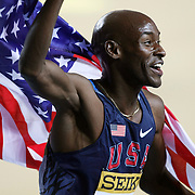 Bernard Lagat of the USA celebrates with national flag after wining in the Men's 3000m final during the IAAF World Indoor Championships at the Atakoy Athletics Arena, Istanbul, Turkey. Photo by TURKPIX