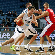 Efes Pilsen's Ender ASLAN (L) during their Turkish Basketball league match Efes Pilsen between Tofas at the Sinan Erdem Arena in Istanbul Turkey on Sunday 27 February 2011. Photo by TURKPIX