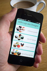Using an iPhone 4G smart phone to look up recipes for cupcakes