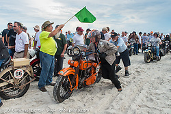 Michel Magnin with his 1926 Harley-Davidson J passes through the start on the sands of Daytona Beach at the beginning of stage 1 of the Motorcycle Cannonball Cross-Country Endurance Run, which on this day ran from Daytona Beach to Lake City, FL., USA. Friday, September 5, 2014.  Photography ©2014 Michael Lichter.