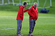 Wales coach Warren Gatland ® shares a joke with Rob Howley. Wales rugby team training  at the Vale resort, Hensol, near Cardiff , South Wales on Tuesday 12th November 2013. pic by Andrew Orchard, Andrew Orchard sports photography,
