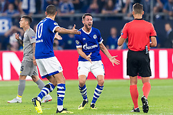 Mark-Alexander Uth of FC Schalke 04 (M) gets a yellow card form referee Jesus Gil Manzano  DFL REGULATIONS PROHIBIT ANY USE OF PHOTOGRAPHS AS IMAGE SEQUENCES AND/OR QUASI-VIDEO. during the UEFA Champions League group D match between Schalke 04 and FC Porto at the Arena auf Schalke on September 18, 2018 in Gelschenkirchen, Germany