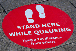 Signs of Covid-19 advising people to stay 2 meters apart and marking where they should stand are visible on the pavements of Sheffield city centre to ensure social distancing is adhered to<br /> <br /> 24 April 2020<br /> <br /> www.pauldaviddrabble.co.uk<br /> All Images Copyright Paul David Drabble - <br /> All rights Reserved - <br /> Moral Rights Asserted -
