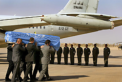 The body of U.N. special envoy to Iraq, Sergio Vieira de Mello, is seen being transported after a memorial for him at the airport in Baghdad, Iraq on Aug.  22, 2003.