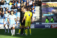 Scott Wootton of Leeds united receives a yellow card from referee Graham Scott. Skybet football league Championship match, Huddersfield Town v Leeds United at the John Smith's Stadium in Huddersfield, Yorks on Saturday 7th November 2015.<br /> pic by Chris Stading, Andrew Orchard sports photography.