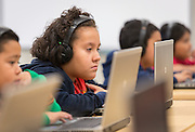 Second grade students work in the technology lab on the first first day of class at the new Sherman Elementary School, December 2, 2013.
