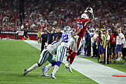 Arizona Cardinals wide receiver Jaron Brown (13) leaps in the air trying to catch an incomplete fourth quarter pass while getting pushed out of bounds by Dallas Cowboys cornerback Orlando Scandrick (32) and Dallas Cowboys outside linebacker Damien Wilson (57) during the 2017 NFL week 3 regular season football game against the against the Dallas Cowboys, Monday, Sept. 25, 2017 in Glendale, Ariz. The Cowboys won the game 28-17. (©Paul Anthony Spinelli)