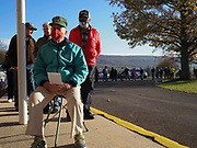 Knowing the wait to vote could be long, John Roberts brought a stool to wait out his time until he voted.