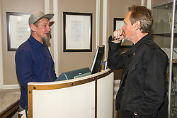 Pictured: There appears to be a booking error as Ian Hart attempts to find Steve Mackintsh a room for the night. <br /> <br /> Steve Mackintosh and Ian Hart stars of the film Life is Rubbish, which is showing at the Edinburgh Intenational Film Festival, were relaxing in the Caledonian Hotel today.<br /> <br /> Ger Harley | EEm 22 June2017