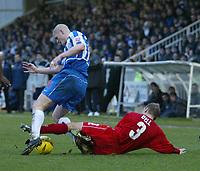 Fotball<br /> England 2004/2005<br /> Foto: SBI/Digitalsport<br /> NORWAY ONLY<br /> <br /> Hartlepool United v Bristol City, Coca-Cola League 1, Victoria Park, Hartlepool 22/01/2005.<br /> Bristol City's Mickey Bell (R) fouls Hartlepool's Michael Nelson (L).