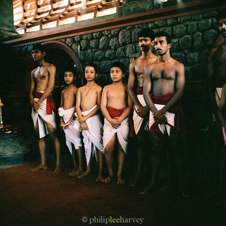 Martial arts students waiting to fight. Kerala, India