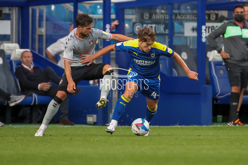 AFC Wimbledon midfielder Alex Woodyard (4) battles for possession during the EFL Trophy Group O match between AFC Wimbledon and Charlton Athletic at the Kiyan Prince Foundation Stadium, London, England on 1 September 2020.