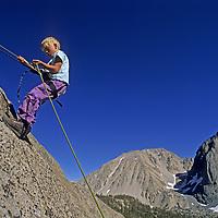 ROCK CLIMBING, Nick Wiltsie (MR) on his first rappel, Big Pine Canyon, John Muir Wilderness, CA. (Sierra Nevada)