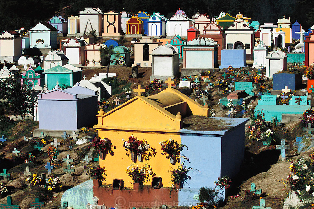 Brightly colored graves in a cemetery at Chichicastenango, Guatemala.