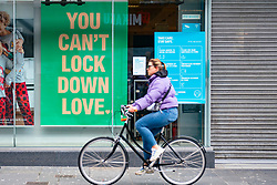 Glasgow, Scotland, UK. 25 November 2020. Glasgow city centre  very quiet during severe level 4 lockdown imposed by the Scottish Government.  Non essential businesses , bars, restaurants and shops are closed. Pictured; Lockdown poster in shop window .Credit.  Iain Masterton