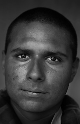 Lcpl. Robert Ornelas, 20, Brownsvile, Texas, Headquarters Platoon, Kilo Co., 3rd Battalion 1st Marines, United States Marine Corps, at the company's firm base in Haditha, Iraq on Sunday Oct. 22, 2005.