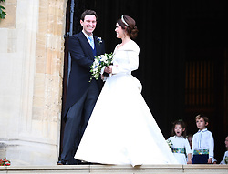 Princess Eugenie and her new husband Jack Brooksbank leave St George's Chapel in Windsor Castle following their wedding.