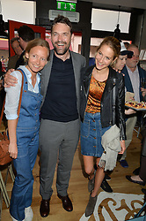 Left to right, MARTHA WARD, DOUGRAY SCOTT and TESS WARD at a party to celebrate the launch of Top Dog at 48 Frith Street, Soho, London on 27th May 2015