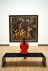 Visitor looking at painting at Statens Museum for Kunst or Royal Museum of Fine Arts in Copenhagen Denmark
