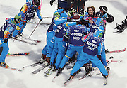 Gold medalist Iouri Podladtchikov (facing, top right), of Switzerland, gathers the snow crew for a hug after his second run in the men's halfpipe at the Rosa Khutor Extreme Park during the Winter Olympics in Sochi, Russia, Tuesday, Feb. 11, 2014. (Brian Cassella/Chicago Tribune/MCT)