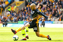 David Silva of Manchester City is tackled Joao Moutinho of Wolverhampton Wanderers - Mandatory by-line: Robbie Stephenson/JMP - 25/08/2018 - FOOTBALL - Molineux - Wolverhampton, England - Wolverhampton Wanderers v Manchester City - Premier League