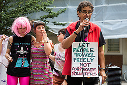 London, UK. 29 July, 2019. A speaker from the All African Women's Group addresses activists from Reclaim the Power, All African Women's Group, Docs Not Cops, Lesbians and Gays Support the Migrants and other groups at a protest outside the Home Office to demand an end to the Government's 'hostile environment' policies.