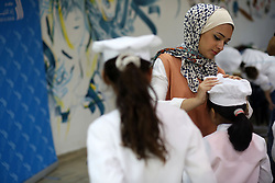 August 5, 2017 - Gaza, gaza strip, Palestine - Palestinian children join in a training program on how to become a chef in Gaza City on Aug. 5, 2017. The young chef training course held at Gaza Zad al-Kheir Restaurant aims at providing culture of cooking for 120 children aged between 6 and 12 years old. (Credit Image: © Majdi Fathi/NurPhoto via ZUMA Press)