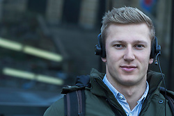 Close-up of young man listening to music with headset, Freiburg im Breisgau, Baden-Wuerttemberg, Germany