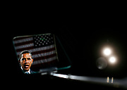 US Democratic presidential nominee Senator Barack Obama (D-IL) is reflected in a teleprompter as he speaks at a campaign event in Toledo, Ohio, October 13, 2008. REUTERS/Jim Young