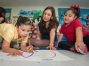 Alma Guerra works with her kindergarten students at Bruce Elementary School, April 24, 2014.