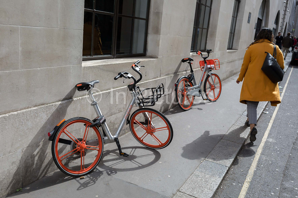 Discarded Mobikes in a side street of the City of London, the capitals financial district, on 25th March 2019, in London, England.