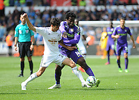 Swansea City's Jack Cork vies for possession with Manchester City's Wilfred Bony<br /> <br /> Photographer Ashley Crowden/CameraSport<br /> <br /> Football - Barclays Premiership - Swansea City v Manchester City - Sunday 17th May 2015 - Liberty Stadium - Swansea<br /> <br /> © CameraSport - 43 Linden Ave. Countesthorpe. Leicester. England. LE8 5PG - Tel: +44 (0) 116 277 4147 - admin@camerasport.com - www.camerasport.com