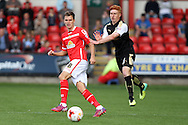 Chris Atkinson of Crewe Alexandra (l) passes the ball under pressure from Tom Smith of Swindon Town. Skybet football league 1 match, Crewe Alexandra v Swindon Town at The Alexandra Stadium in Crewe, Cheshire on Saturday 5th September 2015.<br /> pic by Chris Stading, Andrew Orchard sports photography.