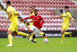 Manchester United's Dillon Hoogewerf controls the ball during the UEFA Youth League, Group F match at Leigh Sports Village, Manchester. Picture date: Wednesday September 29, 2021.
