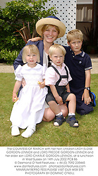 The COUNTESS OF MARCH with her twin children LADY ELOISE GORDON-LENNOX and LORD FREDDIE GORDON-LENNOX and her elder son LORD CHARLIE GORDON-LENNOX, at a luncheon in West Sussex on 14th July 2002.PCB 86
