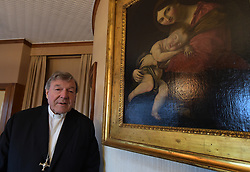 File photo - Australian Cardinal George Pell poses at his office in the San Giovanni Tower at the Vatican on October 16, 2014. Cardinal George Pell has been found guilty of sexual offences in Australia, making him the highest-ranking Catholic figure to receive such a conviction. Pell abused two choir boys in the rooms of a Melbourne cathedral in 1996, a jury found. He had pleaded not guilty. The verdict was handed down in December, but it could not be reported until now due to legal reasons. Pell is due to face sentencing hearings from Wednesday. He has lodged an appeal against his conviction.. Photo by Eric Vandeville /ABACAPRESS.COM