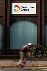 © Licensed to London News Pictures. 20/09/2013, London, UK.  A cyclist passes an office of Direct Line insurer in Croydon, south London,Friday, Sept. 20, 2013. Royal Bank of Scotland (RBS) has raised £630m from selling 20 percent of Direct Line insurance firm. RBS must sell its entire share holding by the end of next year under the EU competition ruling after its bailout by the government is 2008. Photo credit : Sang Tan/LNP