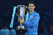 Novak Djokovic with the trophy during the final of the ATP World Tour Finals between Roger Federer of Switzerland and Novak Djokovic at the O2 Arena, London, United Kingdom on 22 November 2015. Photo by Phil Duncan.