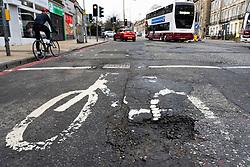 Large pothole in road at cycle track in Edinburgh, Scotland UK
